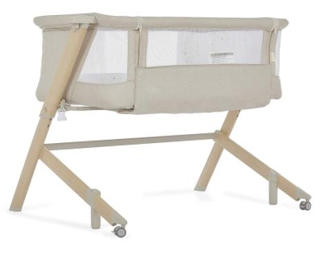 bassinet beside bed