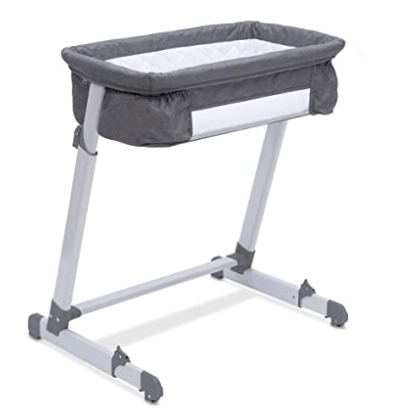 baby bassinet next to bed